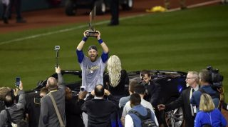Nov 2, 2016; Cleveland, OH, USA; Chicago Cubs outfielder Ben Zobrist (18) holds the MVP trophy after defeating the Cleveland Indians in game seven of the 2016 World Series at Progressive Field. Mandatory Credit: David Richard-USA TODAY Sports